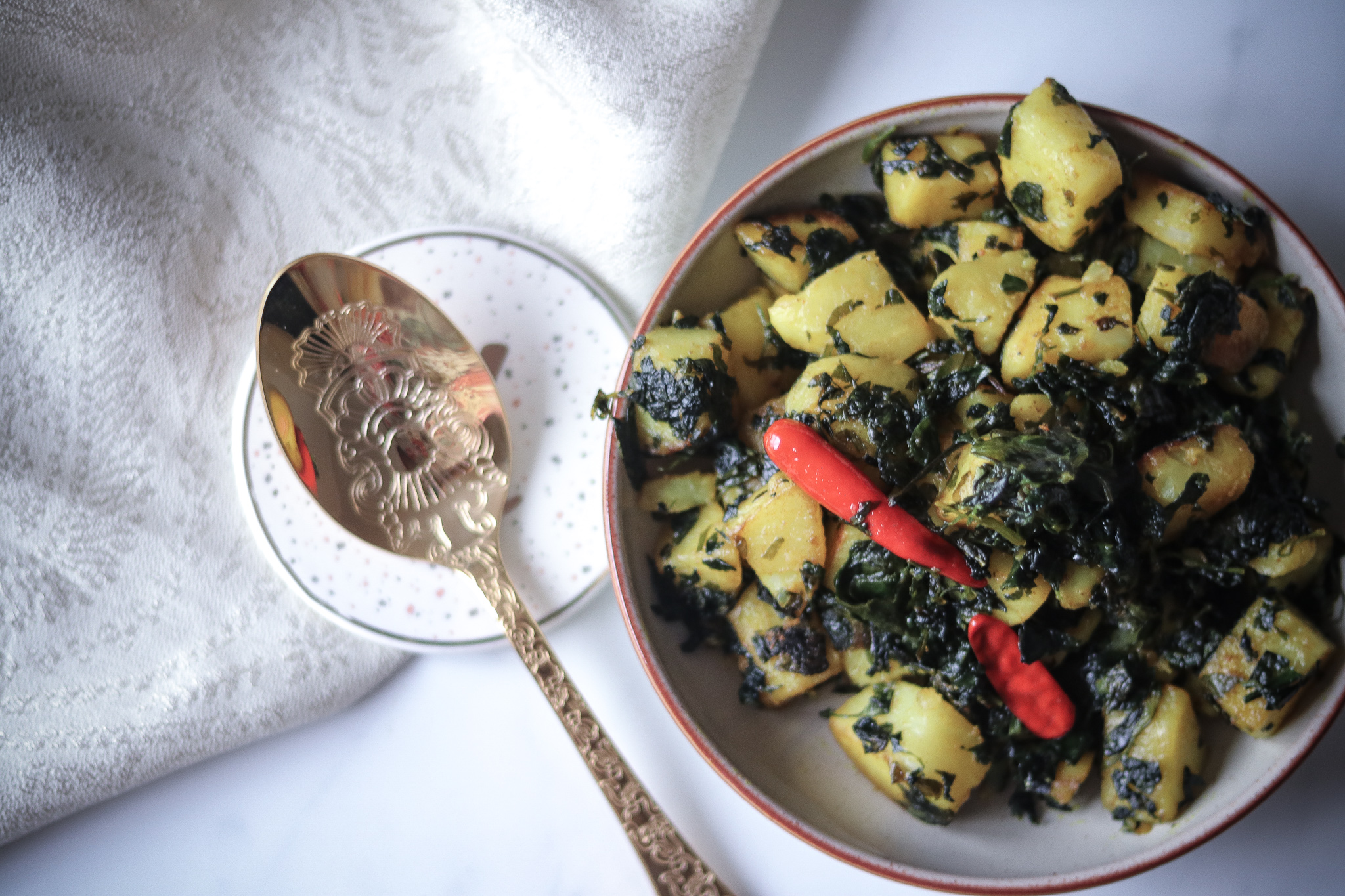aloo methi/ sautéed potatoes and fenugreek leaves