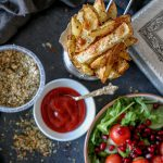 Rosemary spiced Potato wedges served with ketchup and salad