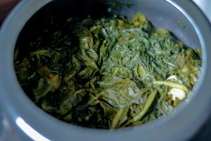 Cooked saag leaves in cooker