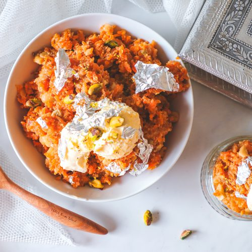 Gajrela served with fresh cream in a white bowl