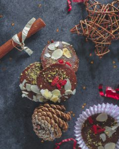 Chocolate discs on a table with christmas decorations