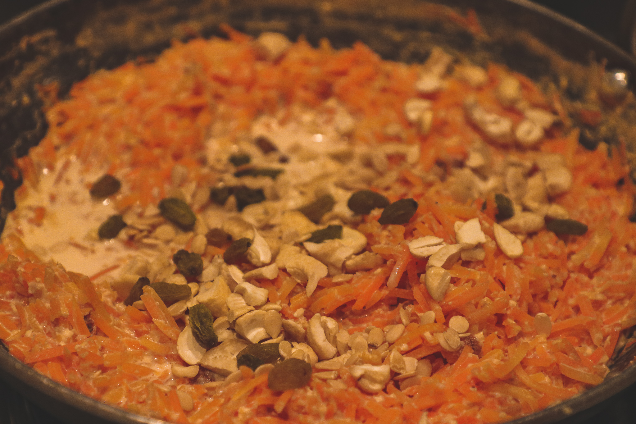 Adding nuts and dry fruit to gajrela