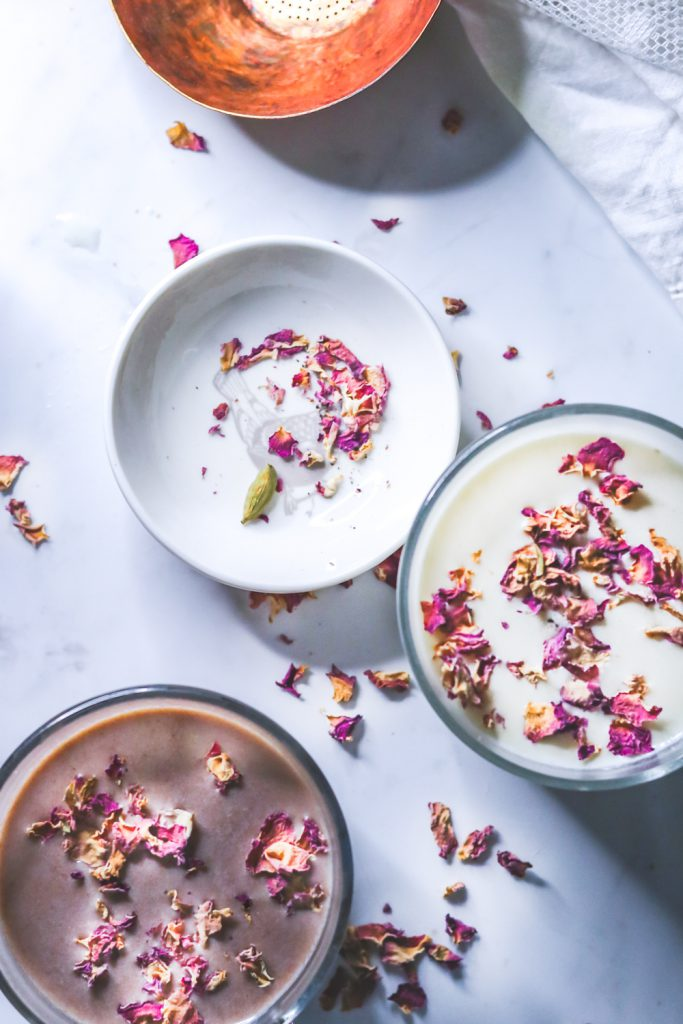 hot chocolates in mugs garnished with rose petals