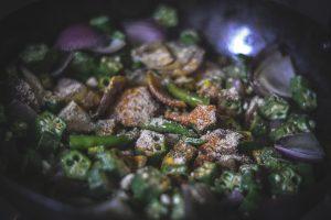 Adding dry spices to bhindi