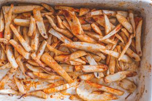 Half cooked baked arbi fries/ taro chips