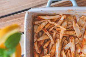 Serving baked arbi fries/ taro chips